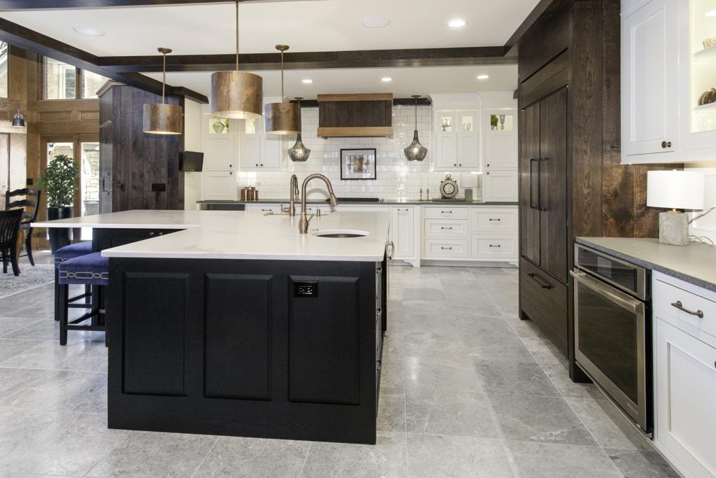kitchen with multi-color cabinet design