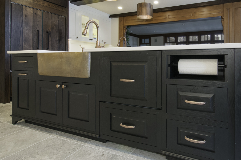 Black kitchen cabinets with paper towel holder
