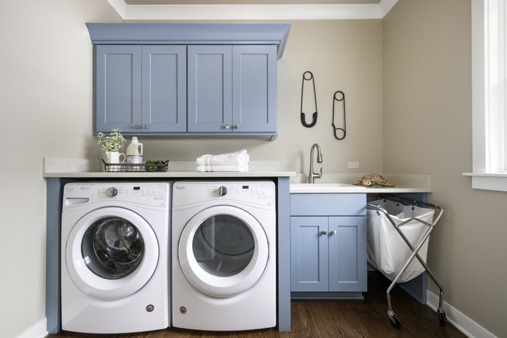laundry room designed with cabinets