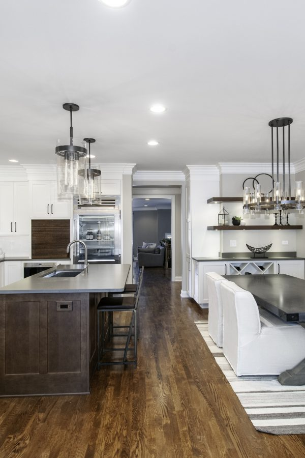 White kitchen with dark wood island renovated by Kane Home Cabinetry & Design located in St. Charles, IL